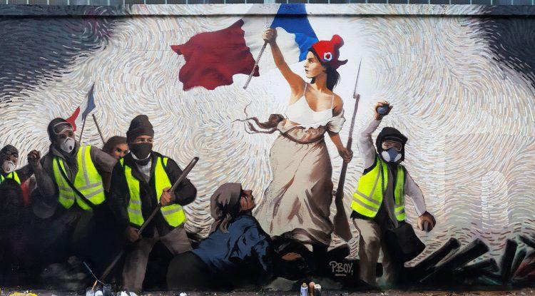 En Francia, un artista callejero esconde en un mural enigma con 1.000 dólares en Bitcoin